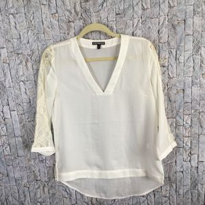 Elegant Ivory blouse with lace inserts on sleeves